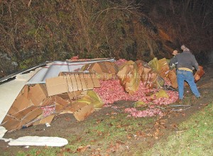 Workers prepare to clean up 43,000 pounds of meat following a tractor-trailer accident Saturday on the AA Highway at Clarksburg. - Dennis Brown Photo