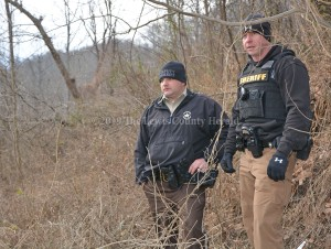 Deputy Matt Ross, left, and Deputy Mark Sparks at the scene of a death investigation Friday afternoon near Garrison. - Dennis Brown Photo