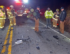 Officials examine the scene of a double fatality early Sunday on KY 8 at Black Oak. The drivers of both vehicles were pronounced dead at the scene. The roadway remained closed for nearly eight hours to allow for the investigation and cleanup of the scene.