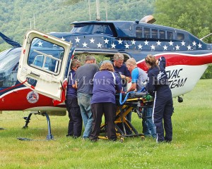 Emergency workers load a patient onto a medical helicopter following a motorbike crash on Quick's Run Road. - Dennis Brown Photo