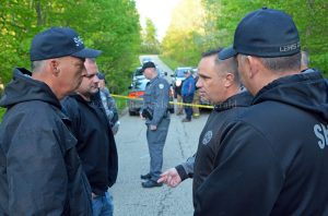 Sheriff Johnny Bivens talks with deputies at the location where human remains were discovered on Wednesday. The remains have been identified as those of a missing Vinton County, Ohio, man. - Dennis Brown Photo